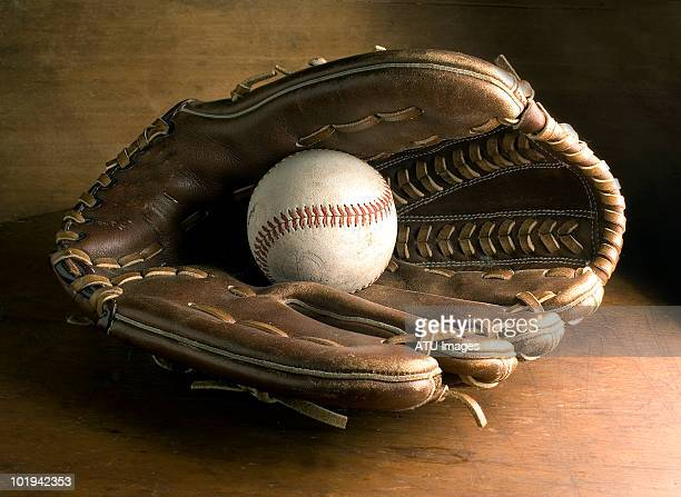 baseball glove on wood