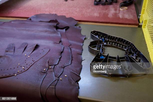 e2e5bba7711 A baseball glove pattern sits next to pieces of leather at the Nokona  manufacturing facility in