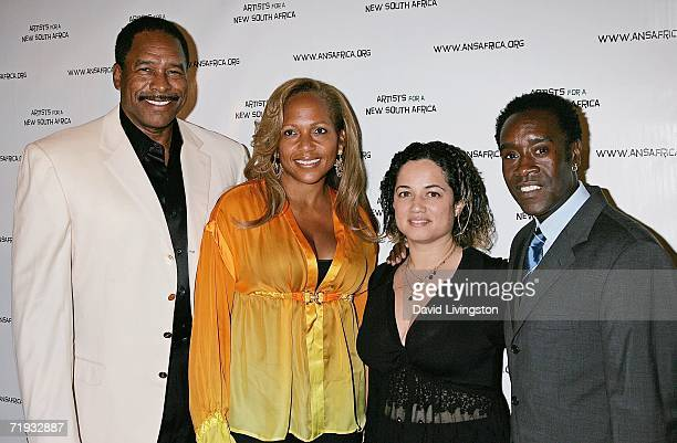 Baseball great Dave Winfield his wife Tonya actress Bridgid Coulter and actor Don Cheadle attend Archbishop Desmond Tutu's 75 birthday gala...