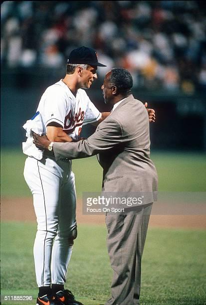 Baseball Great Hank Aaron congratulates Cal Ripken Jr of the Baltimore Orioles for playing in his 2131st consecutive Major League baseball game...