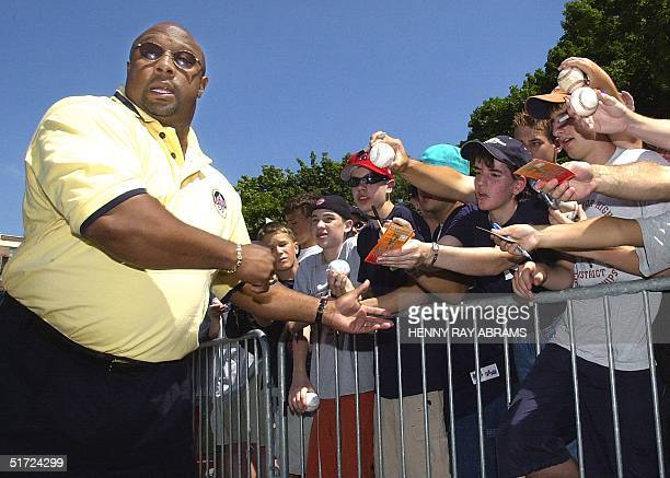 Baseball Hall of Fame inductee Kirby Puckett signs autographs outside Doubleday Field before the Hall of Fame Game in Cooperstown NY 06 on August...