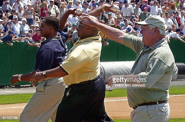 Baseball Hall of Fame inductees Bill Mazeroski Kirby Puckett and Dave Winfield throw out the ceremonial first pitch before the 2001 Hall of Fame game...