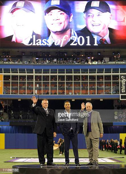 2011 Baseball Hall of Fame Inducties Burt Blyleven Roberto Alomar and Pat Gillick acknowledge the crowd during a ceremony for them prior to the...