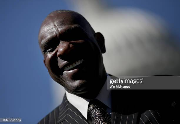 Baseball Hall of Famer Andre Dawson listens as Sen Tim Scott speaks during a press conference outside the US Capitol July 18 2018 in Washington DC...