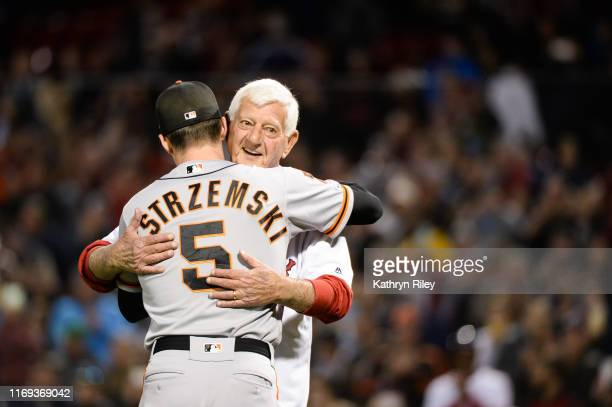Baseball Hall of Famer Carl Yastrzemski hugs his grandson Mike Yastrzemski of the San Francisco Giants prior to throwing out a ceremonial first pitch...