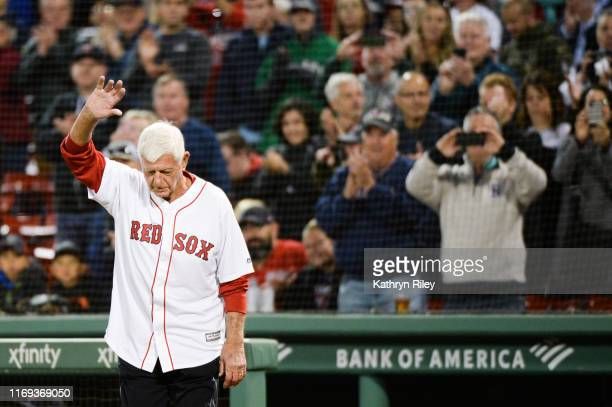 Baseball Hall of Famer Carl Yastrzemski steps onto the field prior to throwing out a ceremonial first pitch for the game between the San Francisco...
