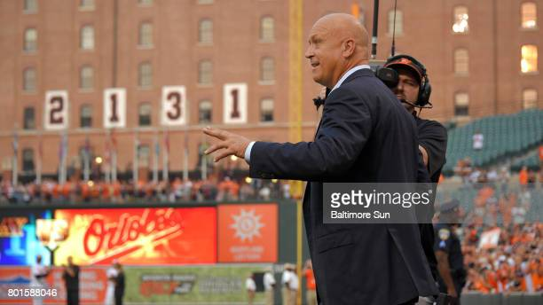Baseball Hall of Famer, retired Baltimore Orioles infielder Cal Ripken Jr., acknowledges fans as he makes his way from the dugout during the 20th...