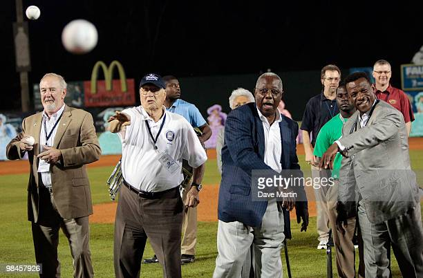 Baseball Hall of Famers Bruce Sutter Bob Feller Hank Aaron and Rickey Henderson throw out the first pitch during pregame ceremonies following the...
