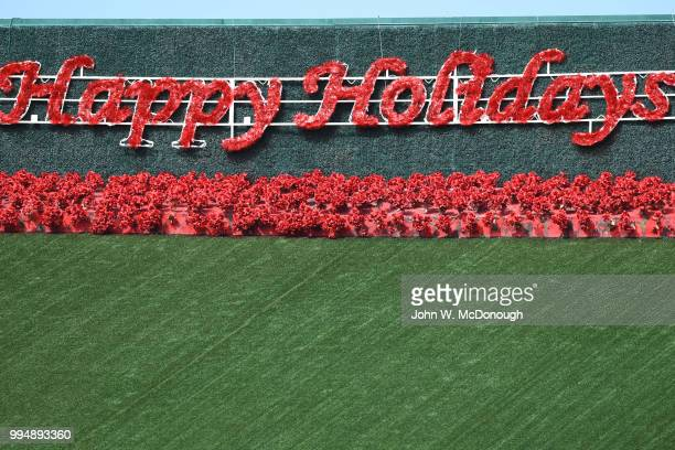 Happy Holidays sign for Christmas in June event before Los Angeles Angels vs Toronto Blue Jays at Angel Stadium Anaheim CA CREDIT John W McDonough