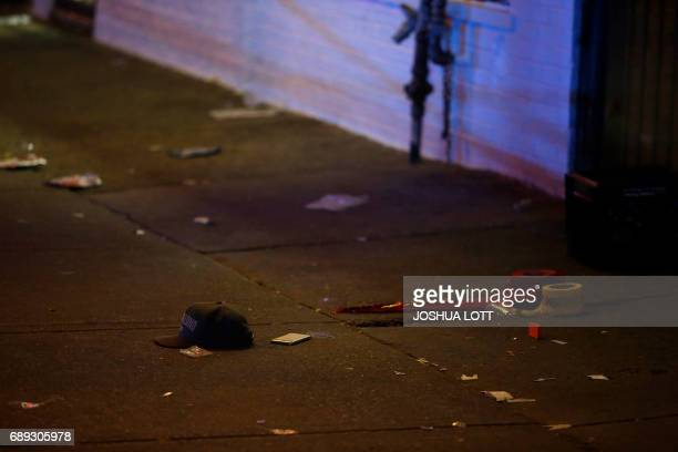 A baseball hat and mobile phone rest next to crime scene tape where a man was shot in the 7100 block of South State Street on May 28 2017 in Chicago...