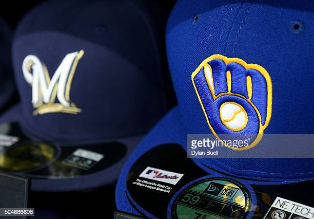 Baseball hats with the current logo left and retro logo sit on display at Miller Park on April 24 2016 in Milwaukee Wisconsin
