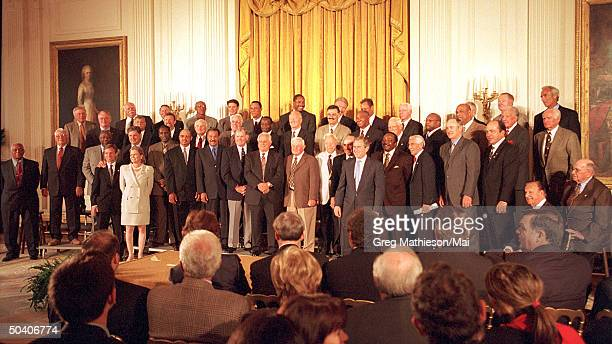 Baseball heroes and Hall of Fame members assembling in the East Room of the White House for reception held by President George W Bush