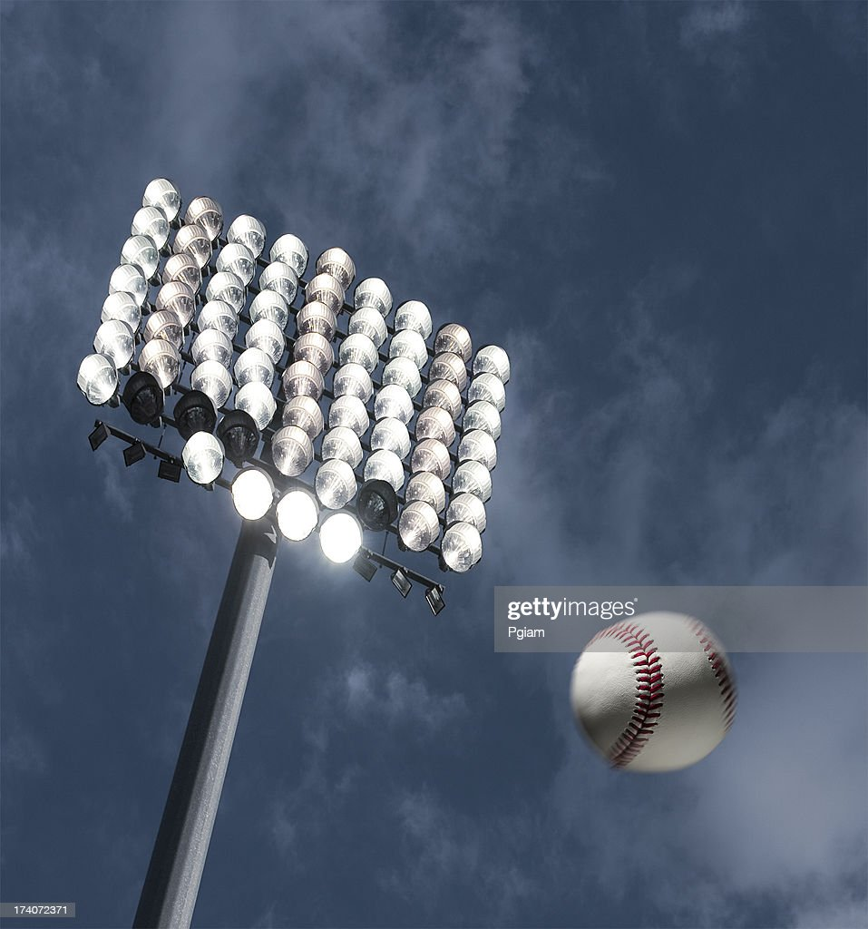 Baseball home run under the stadium lights : Stock Photo