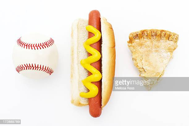 Baseball, hot dog and a slice of apple pie.
