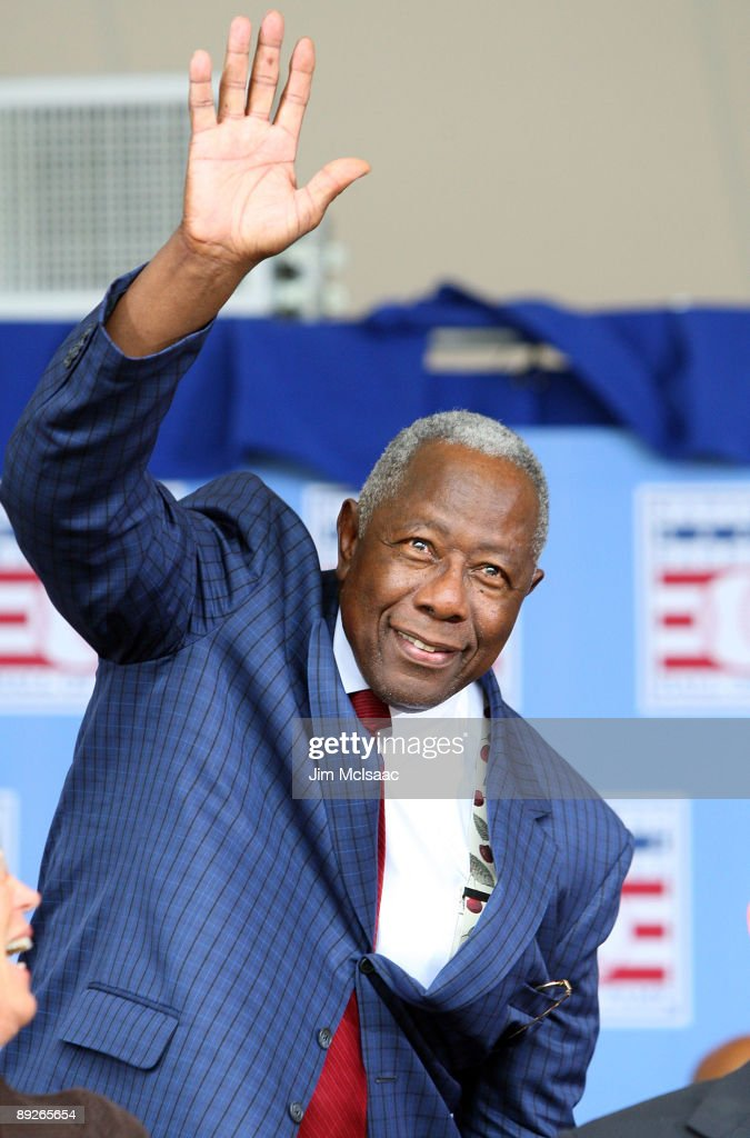 Baseball icon Hank Aaron waves to the crowd at Clark Sports Center during the 2009 Baseball Hall of Fame induction ceremony on July 26, 2009 in Cooperstown, New York.