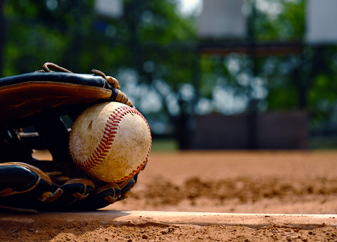 Baseball in glove on team field. 1132796573