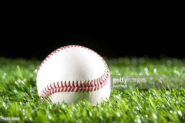 Baseball in the grass at night