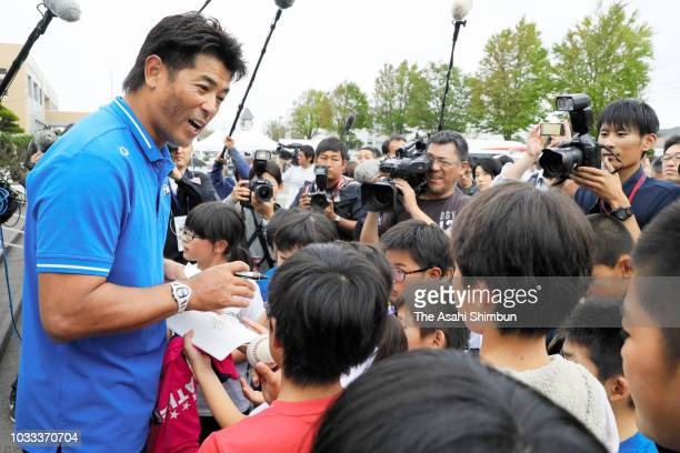 Baseball Japan national team head coach Atsunori Inaba signs autographs for young fans a week after the magnitude 67 earthquake on September 13 2018...