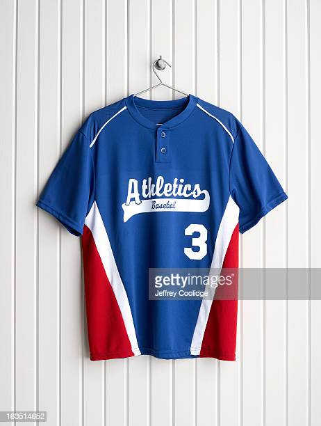 baseball jersey on coat hanger - sports jersey stock pictures, royalty-free photos & images