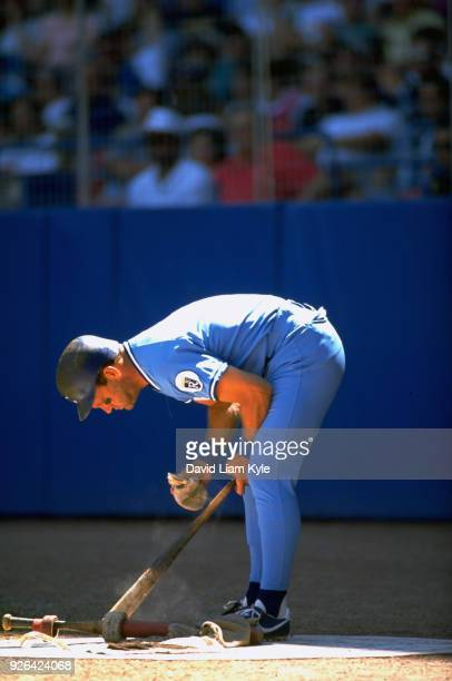 Kansas City Royals George Brett putting pine tar on bat in on deck circle during game vs Cleveland Indians at Cleveland Stadium Cleveland OH CREDIT...