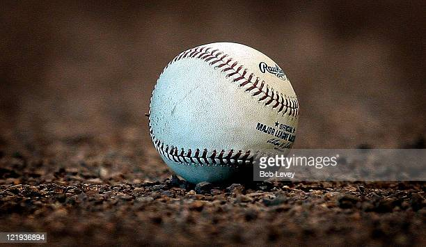 A baseball lays on the infield dirt at Minute Maid Park on August 21 2011 in Houston Texas San Francisco won 64