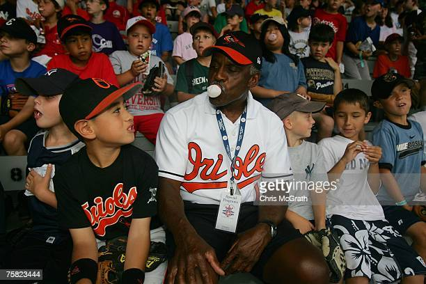 Baseball legend Al Bumbry blows a bubble nwith a young fan during a rainedout coaching clinic held at Doubleday Field on July 27 2007 in Cooperstown...