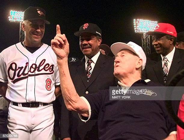 Baseball legend and former Boston Red Sox star Ted Williams talks with AllStar Cal Ripken Jr of the Baltimore Orioles as AllCentury players Juan...