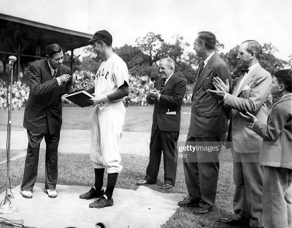 Baseball legend Babe Ruth presents his papers to Yale University in 1948. They are received by Yale baseball team captain, George Bush. Also present are: Bob Kiplurth, Yale Athletic Director; Professor James T. Babb, Yale University Librarian for Preservation; and Mayor Celentano and his son.
