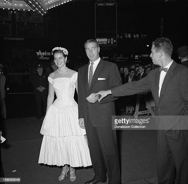 Baseball legend Joe DiMaggio and girlfriend former Miss America and actress Lee Meriwether attend the opening night of Judy Garland at the RKO Palace...