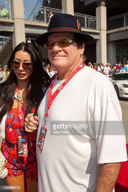 Baseball legend Pete Rose and Kiana Kim attends the 2012 Indianapolis 500 at Indianapolis Motorspeedway on May 27 2012 in Indianapolis Indiana