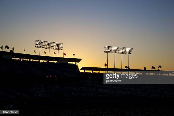 baseball lights at sunset - stadium lights stock photos and pictures