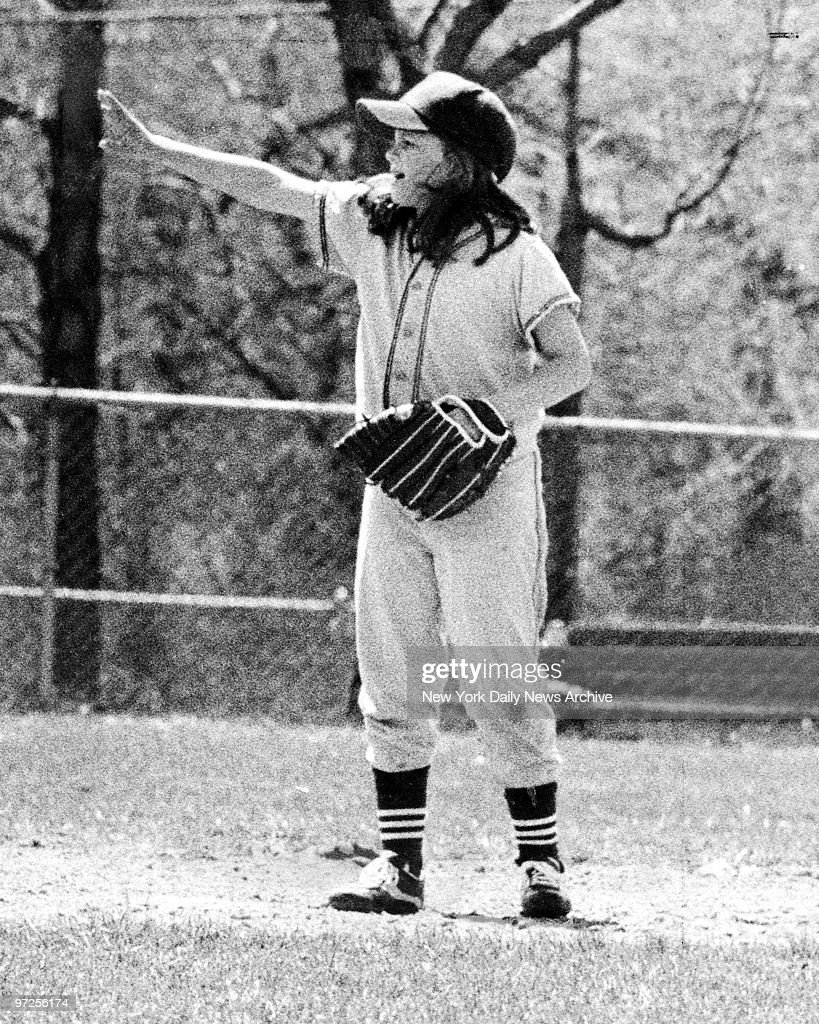 Baseball Little League Bitsy Osder, 9-year-old girl gives the boys direction.