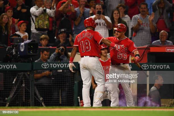 Los Angeles Angels Luis Valbuena and Kole Calhoun victorious in dugout during game vs Toronto Blue Jays at Angel Stadium Anaheim CA CREDIT John W...