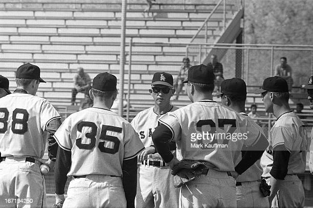 Los Angeles Angels manager Bill Rigney with players during spring training at Angels Stadium The Angels inaugural season after becoming an expansion...
