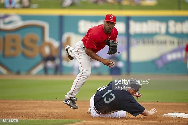 Los Angeles Angels of Anaheim Howie Kendrick in action turning double play vs Seattle Mariners Chris Shelton during spring training Peoria AZ...