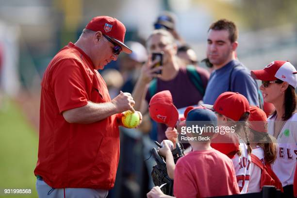 Los Angeles Angels of Anaheim manager Mike Scioscia signing autographs for fans during spring training at Tempe Diablo Stadium Tempe AZ CREDIT Robert...