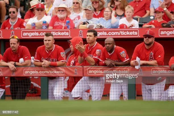 Los Angeles Angels of Anaheim Mike Trout Ian Kinsler Justin Upton and hitting coach Eric Hinske in dugout during spring training game vs San...