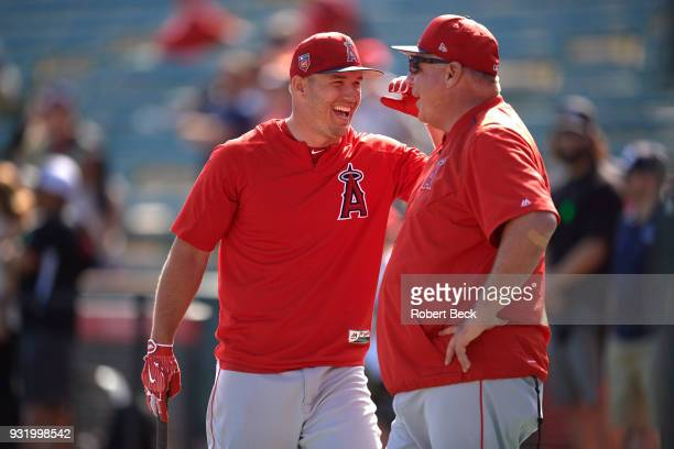 Los Angeles Angels of Anaheim Mike Trout with manager Mike Scioscia during batting practice during spring training at Tempe Diablo Stadium Tempe AZ...