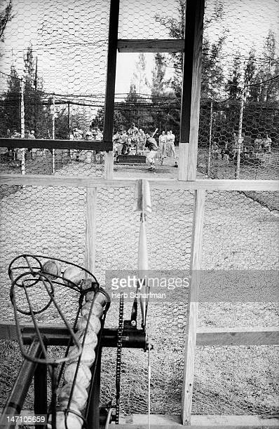 Los Angeles Dodgers Larry Sherry taking batting practice in cage from pitching machine during spring training at Dodgertown Vero Beach FL CREDIT Herb...