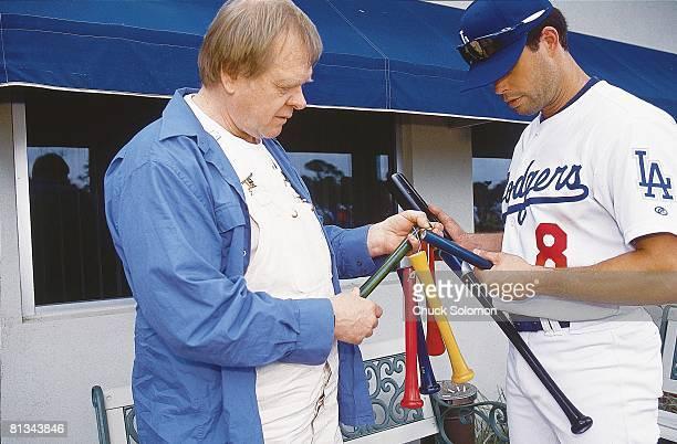 Baseball Los Angeles Dodgers Mark Grudzielanek and bat maker Sam Holman during spring training Vero Beach FL 2/20/2002