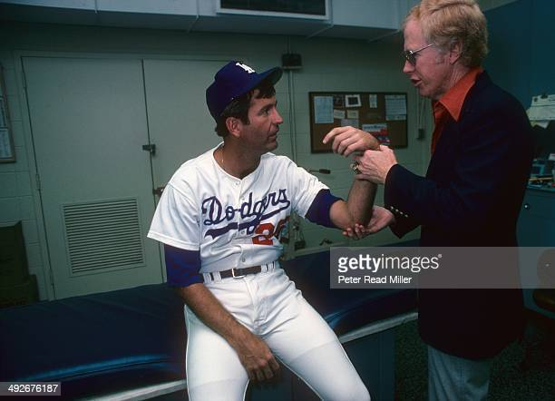 Los Angeles Dodgers orthopedist Dr. Frank Jobe examines the elbow of Tommy John in trainer's room at Dodger Stadium. Dr. Jobe previously replaced the...