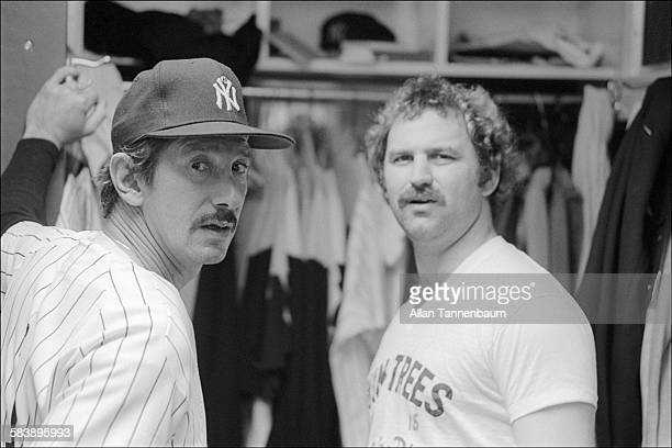 Baseball manager Billy Martin and catcher Thurman Munson both of the New York Yankees talk in the locker room after a game New York New York June 21...