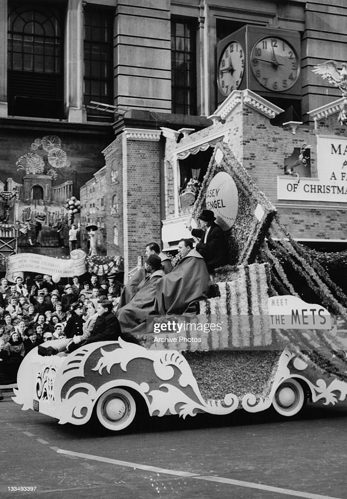 Baseball manager Casey Stengel (1890 - 1975) sits atop the 'Meet The Mets' parade float, during the Macy's Day Parade at Thanksgiving in New York City, 26th November 1961. The New York Mets were founded in 1962, and this served as an introduction to the new team. A number of tableaux behind commemorate landmarks in the city's history.