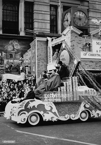 Baseball manager Casey Stengel sits atop the 'Meet The Mets' parade float during the Macy's Day Parade at Thanksgiving in New York City 26th November...