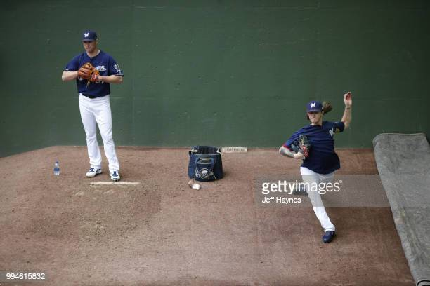 Milwaukee Brewers Chase Anderson and Josh Hader warming up before game vs Kansas City Royals at Miller Park Milwaukee WI CREDIT Jeff Haynes