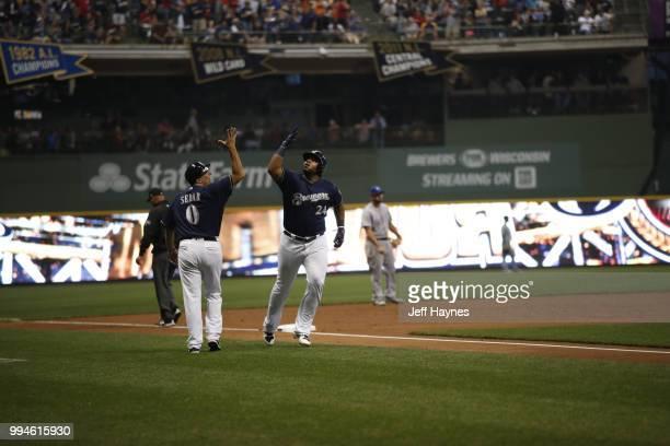 Milwaukee Brewers third base coach Ed Sedar and Jesus Aguilar before game vs Kansas City Royals at Miller Park Milwaukee WI CREDIT Jeff Haynes
