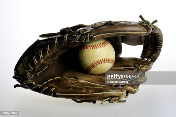 baseball mitt and ball on a white background - baseball glove stock pictures, royalty-free photos & images
