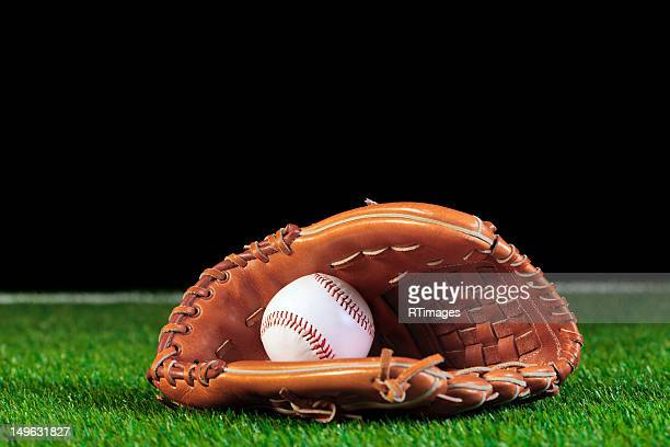 baseball mitt and ball on grass - baseball glove stock pictures, royalty-free photos & images