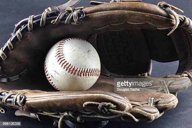 Baseball mitt with ball sports equipment