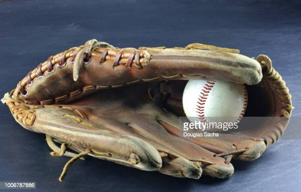 baseball mitt with hard ball - baseball glove stock pictures, royalty-free photos & images